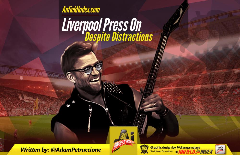 Liverpool Press On Despite Distractions