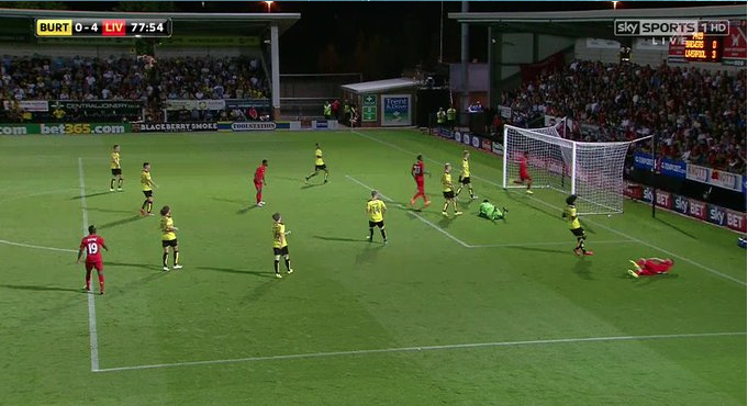 Here we see an image of Sturridge's goal against Burton. With Origi occupying a central position and attracting defenders, thereby allowing Sturridge to drift into space at the far post for a simple tap-in.